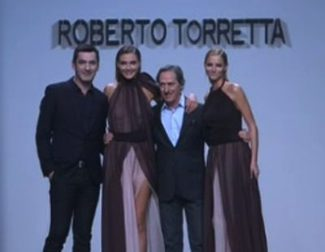 Las 'working girls' de Roberto Torretta pisan fuerte sobre la pasarela de Fashion Week Madrid