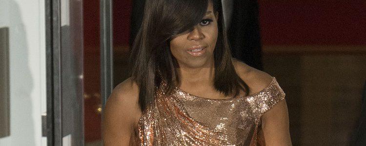 Michelle Obama con un vestido de color oro rosa en su última cena de Estado en Italia