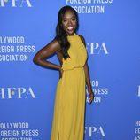 Aja Naomi King con vestido largo amarillo