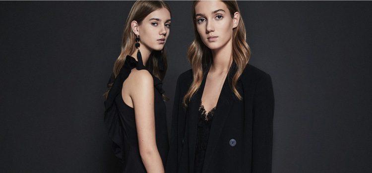 Modelos posando con prendas de color negro de la colección de fiesta de Lefties