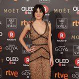 Macarena García con un look floral en la alfombra roja de los Premios Goya 2018