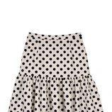 Falda blanca de topos negros de la colección de Dándara
