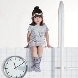 Vestido gris con estampados infantiles de Tuc Tuc primavera/verano 2018