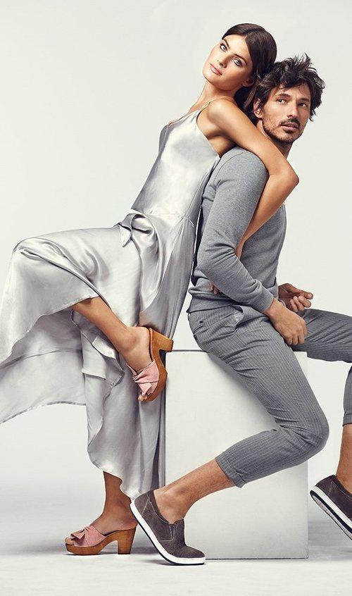 Isabel Fontana y Andrés Velencoso posando con zapatos de tonalidad pastel para Carmela primavera/verano 2018