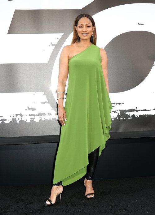 Garcelle Beauvais con un vestido verde y un pantalón negro en el estreno de 'The Equalizer 2'  2018