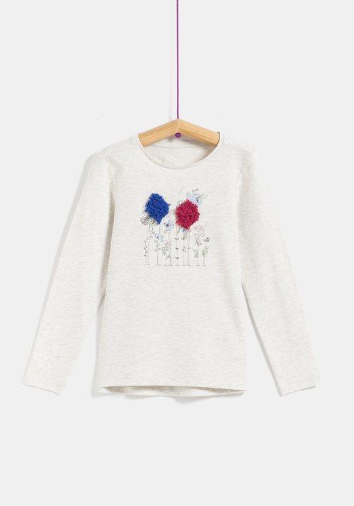 Camiseta blanca con flores para niña de la colección 'I-O' de Carrefour y TEX para otoño/invierno 2019