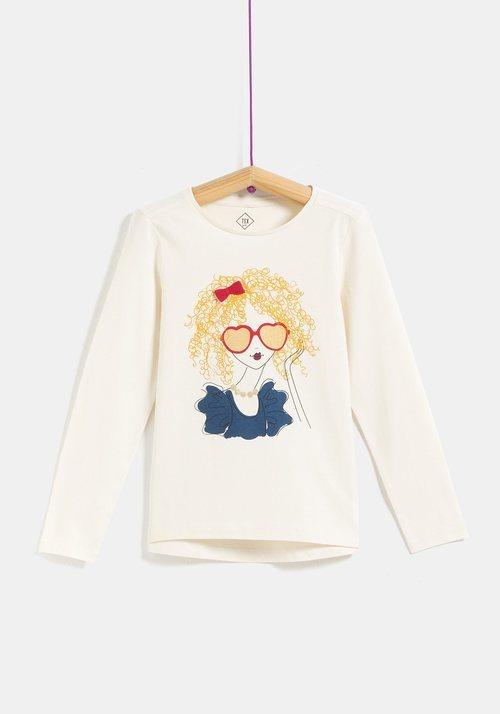 Camiseta blanca con dibujo de chica para niña de la colección 'I-O' de Carrefour y TEX para otoño/invierno 2019