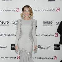 Miley Cyrus con vestido de Roberto Cavalli en la fiesta de Elton John tras los Oscar 2012