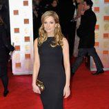 Joanne Frogatt con un vestido negro y largo de Victoria Beckham