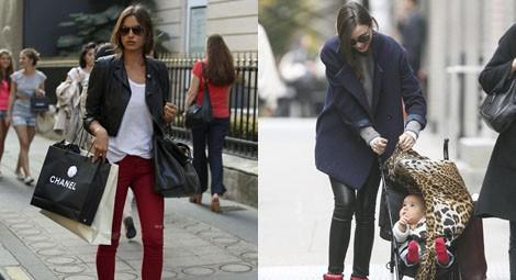 Irina Shayk con pantalones rojos, chaqueta de cuero negra y sneakers de Isabel Marant