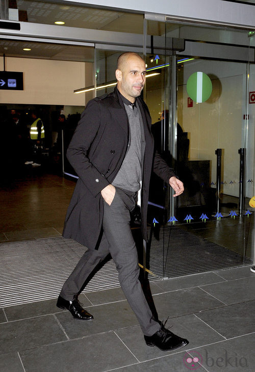Guardiola con abrigo tras un partido