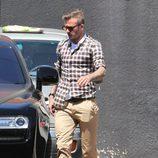 David Beckham con camisa de cuadros en tonos marrones
