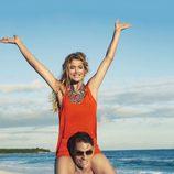 Doutzen Kroes con un vestido naranja de la colección primavera/verano 2013 de H&M