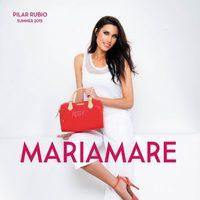 Pilar Rubio con sandalias naranjas de tacón de la colección primavera/verano 2015 de Maria Mare