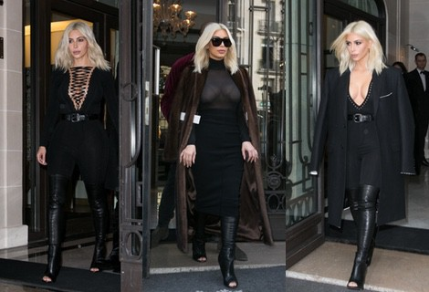 Kim Kardashian con un jumpsuit negro y botas 'peep toe' en la Paris Fashion Week